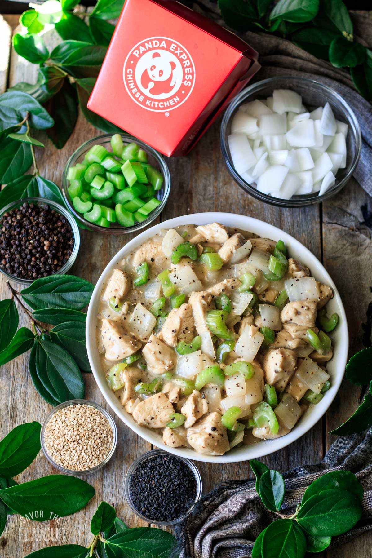 bowl of Panda Express black pepper chicken with bowls of garnishes