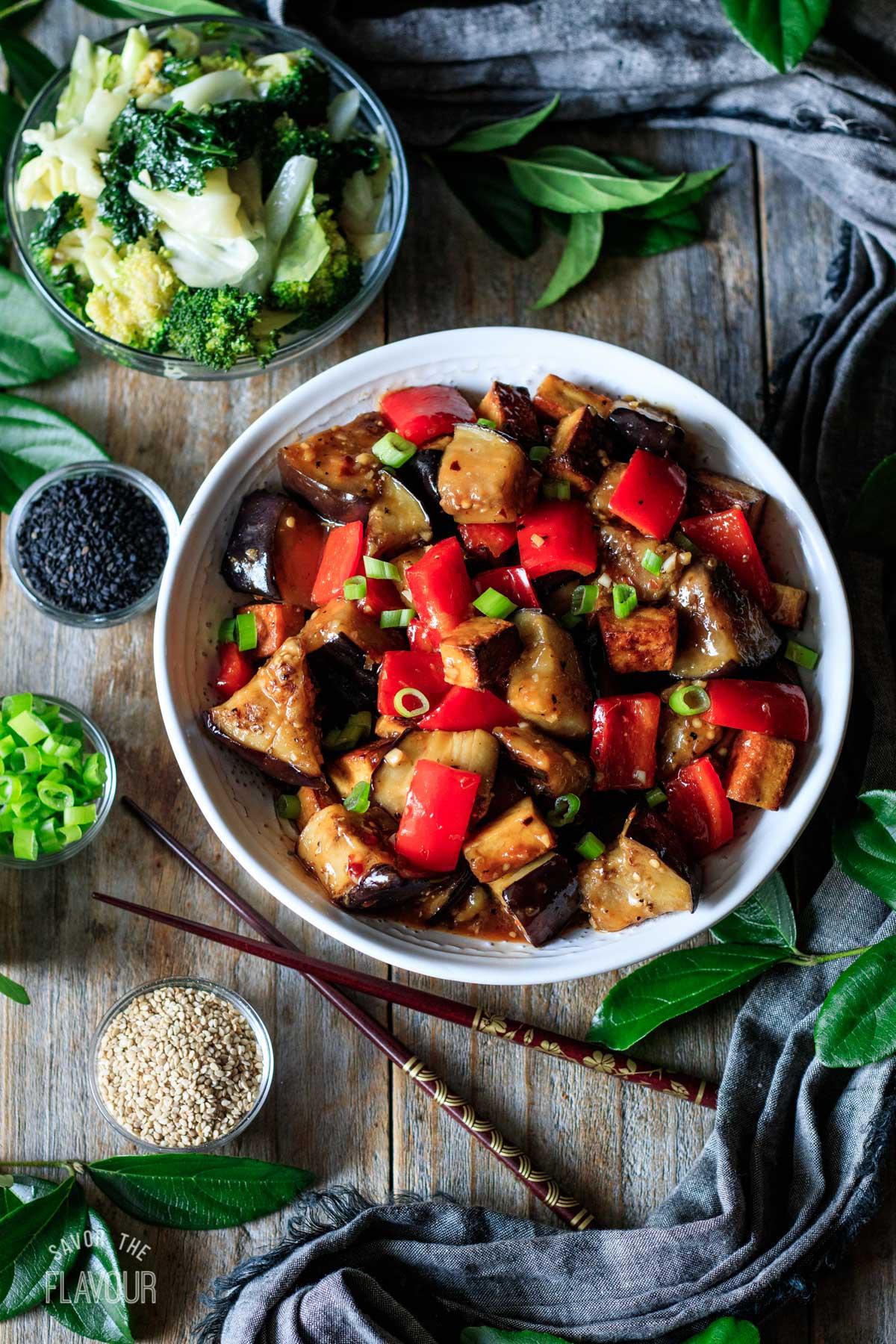 bowl of Panda Express eggplant tofu with chopsticks