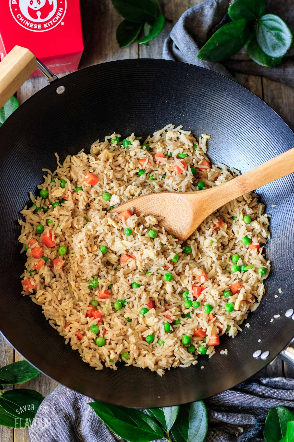 copycat Panda Express fried rice in a large wok with a wooden spoon