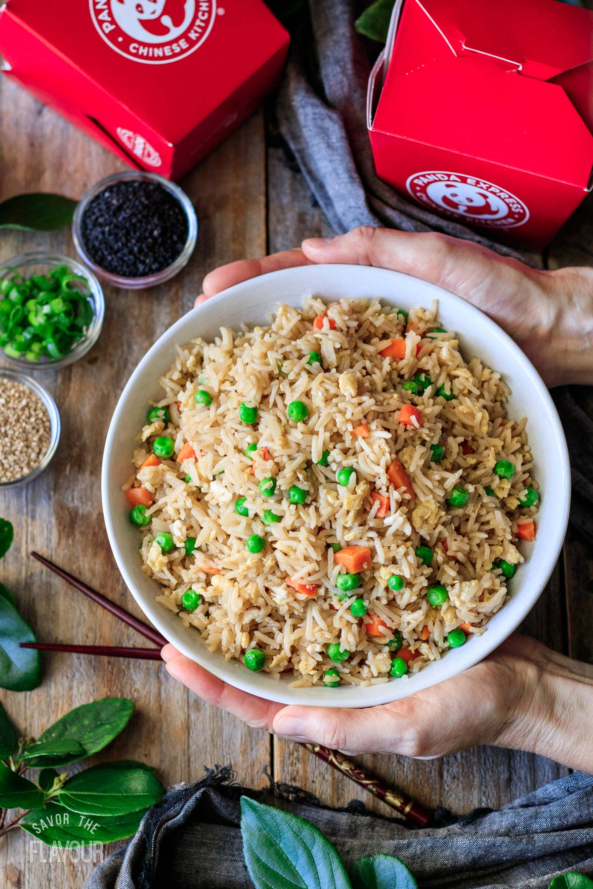 person holding a bowl of copycat Panda Express fried rice
