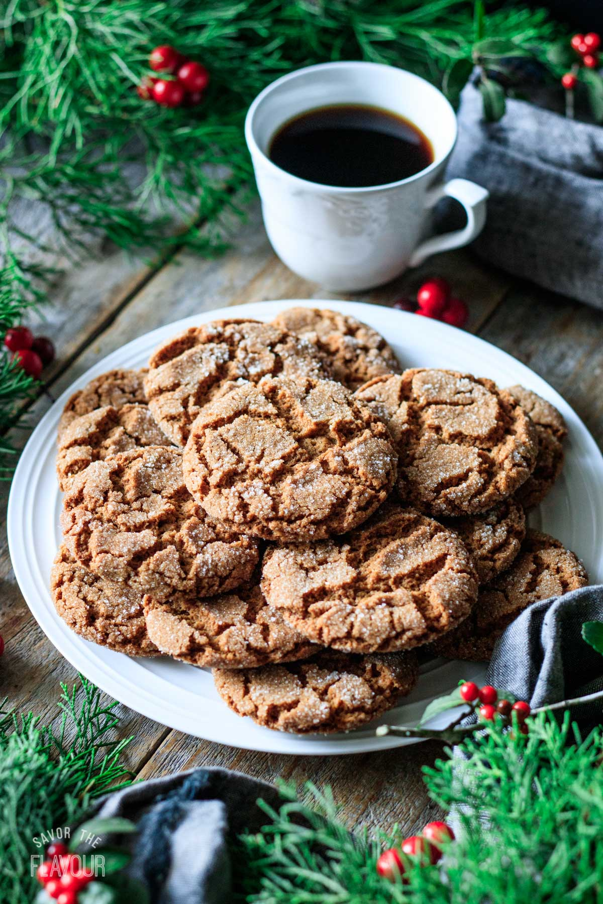 plate of vegan gingersnaps with a cup of coffee