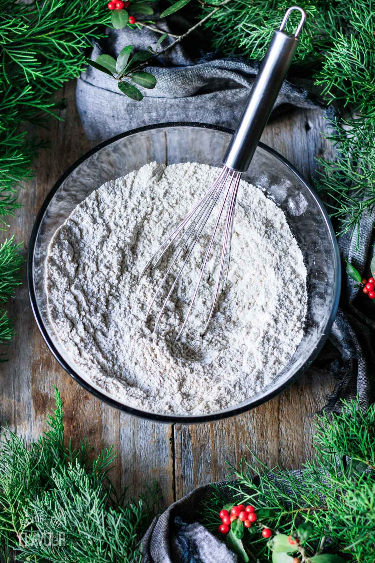 whisked flour and spice mixture in a glass bowl