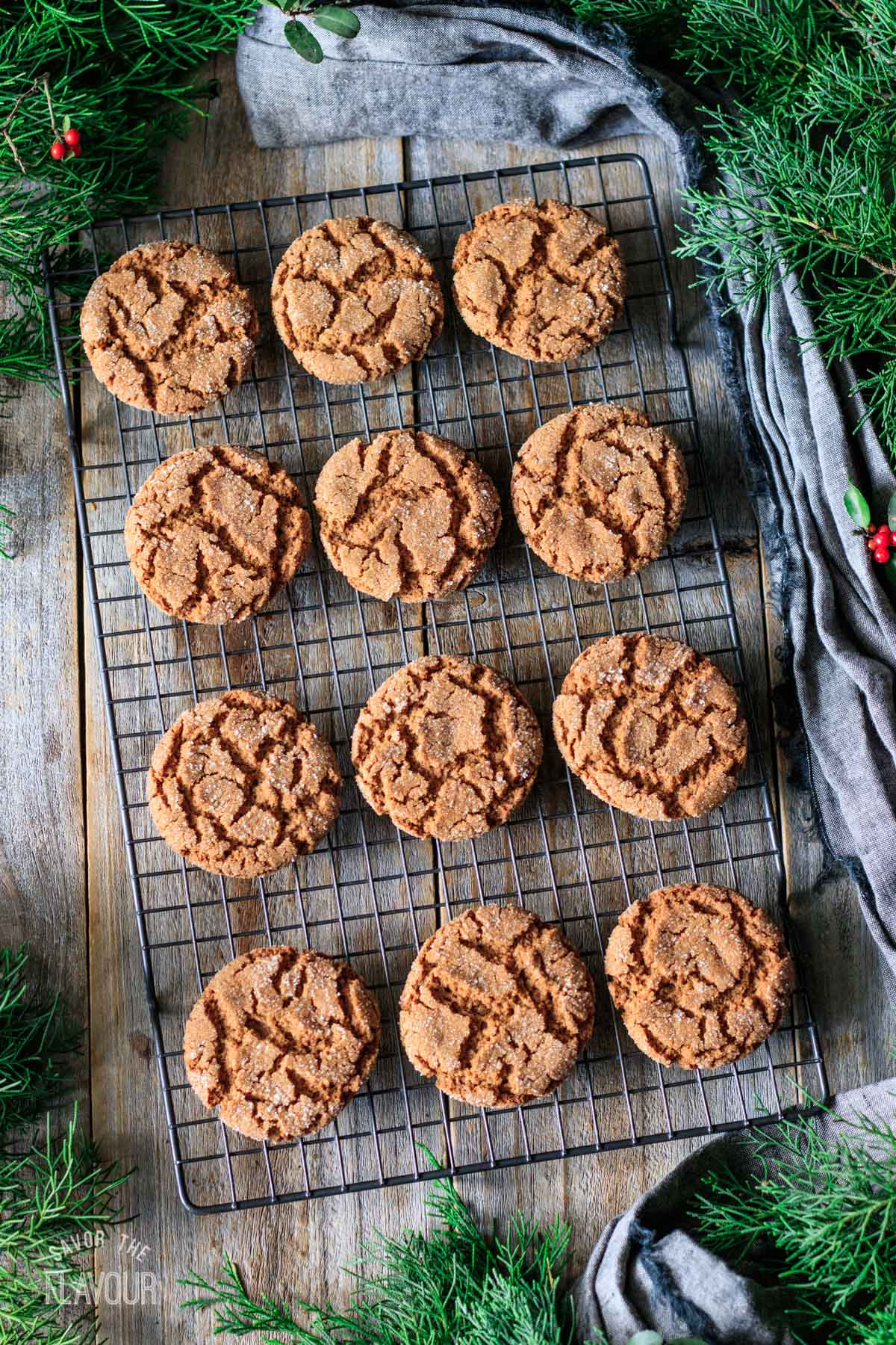 baked vegan gingersnaps on a wire cooling rack