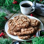 plate of vegan gingersnap cookies with a cup of coffee