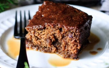 slice of sticky toffee pudding on a plate with a fork