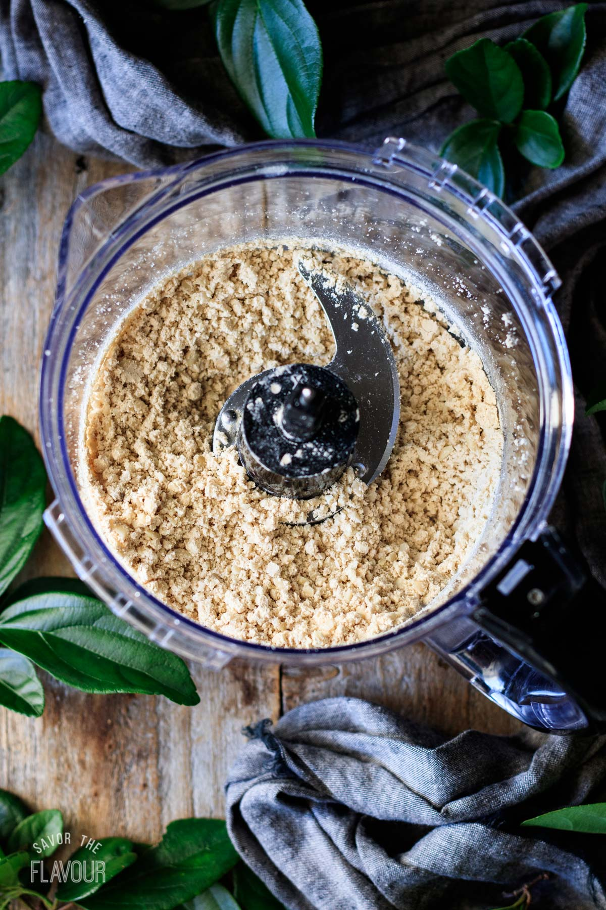 chopped almonds and protein powder in a food processor