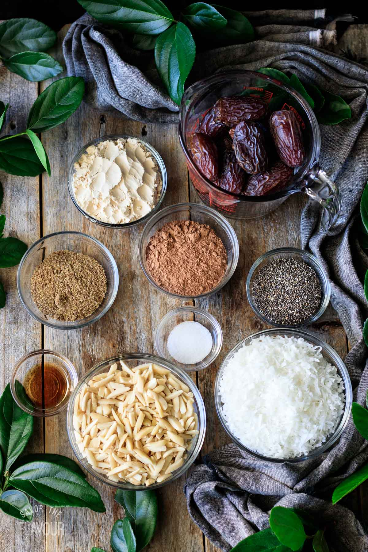 bowls of ingredients for date protein balls