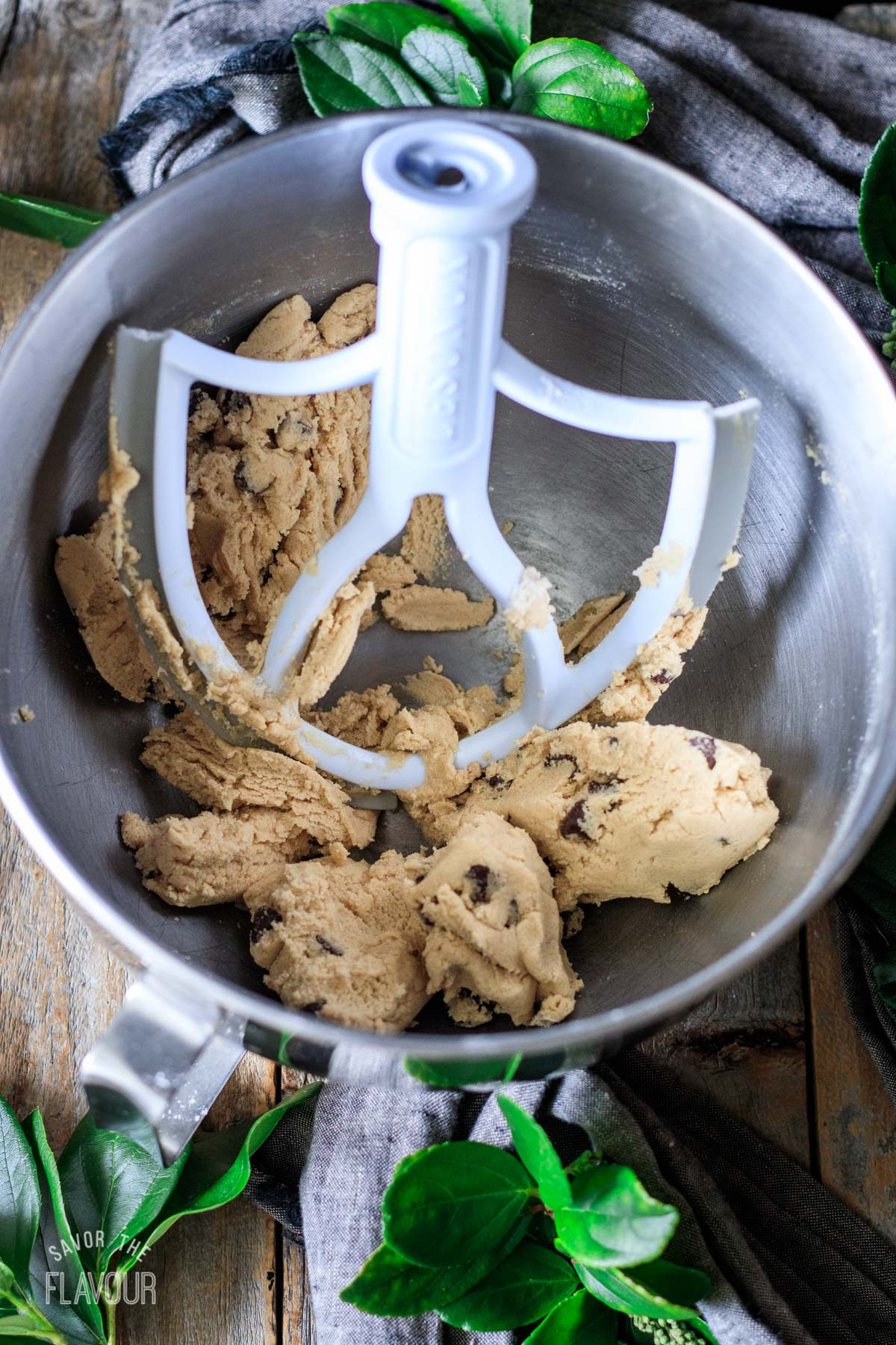 no bake cookie dough in a mixing bowl with the paddle attachment