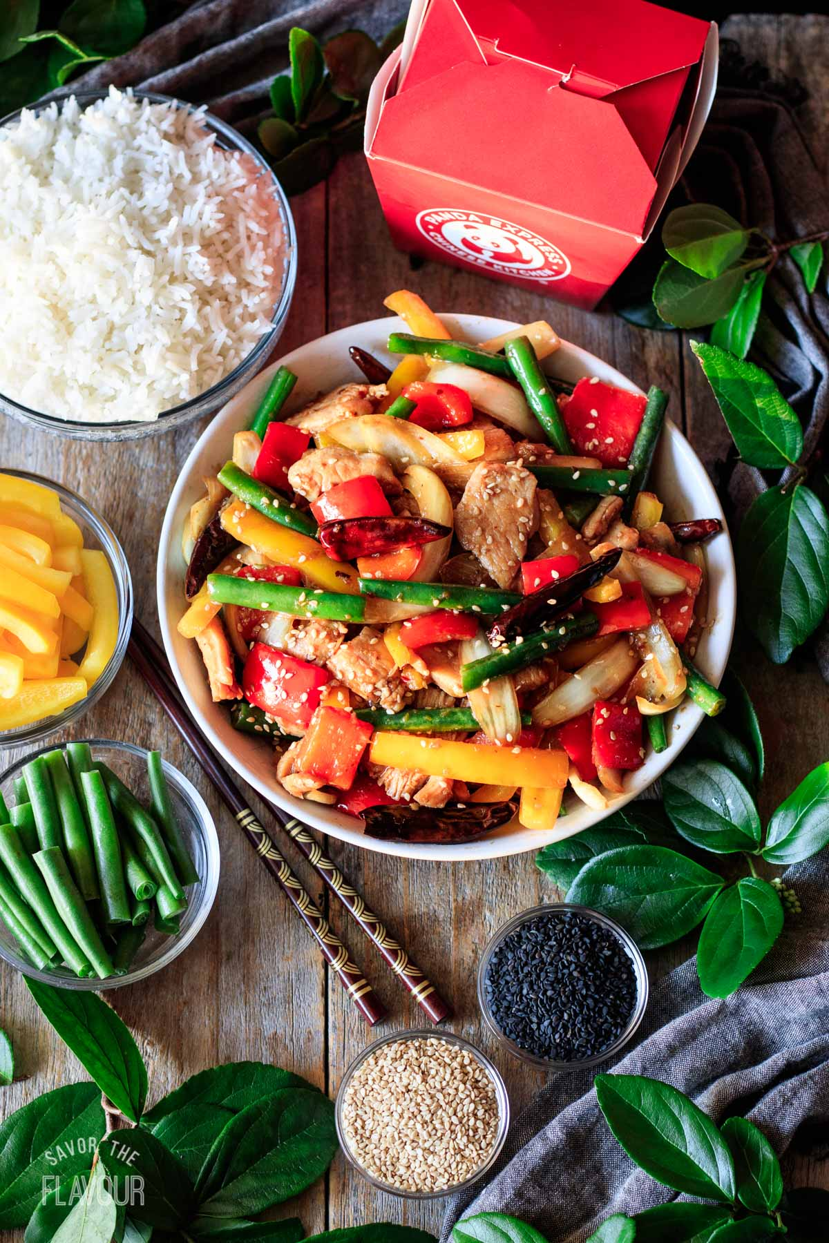 bowl of firecracker chicken with bowls of sides and garnishes