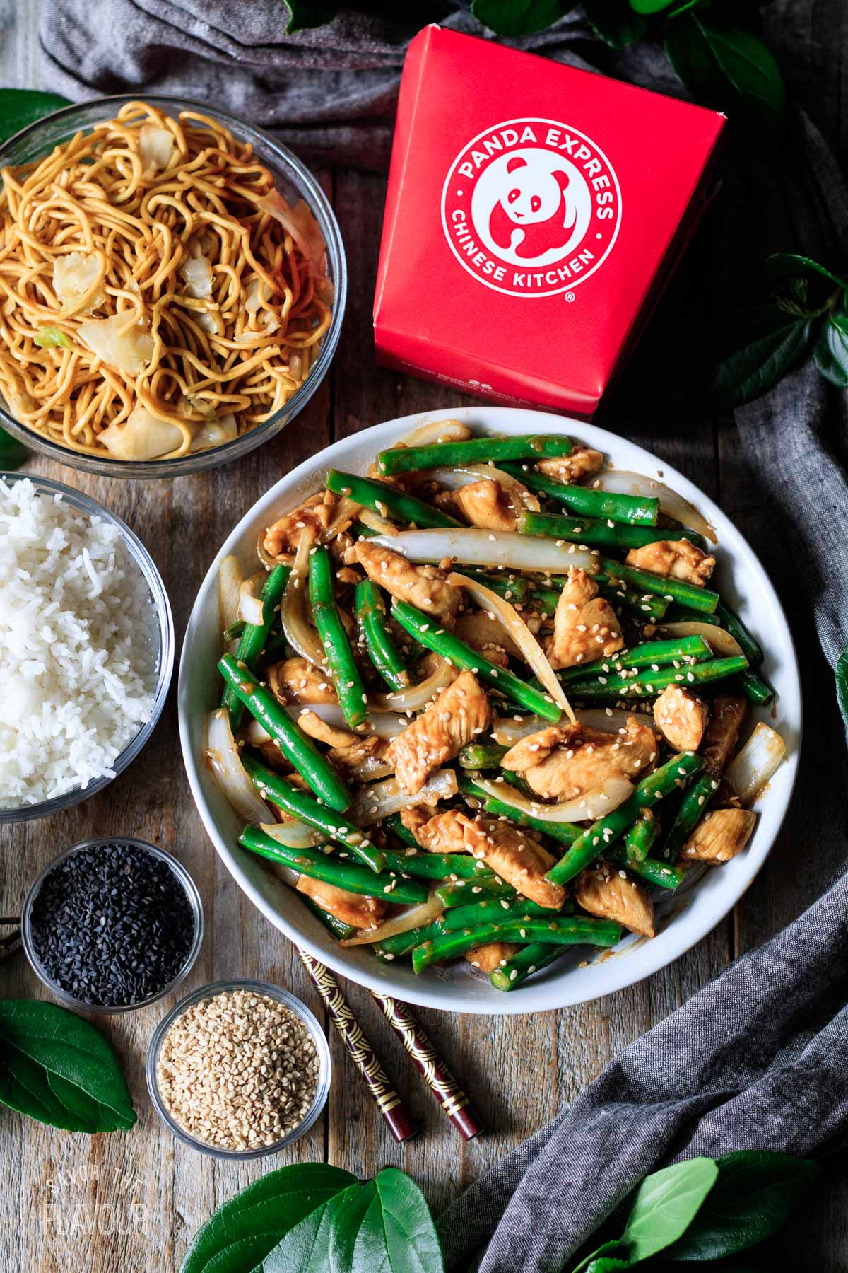 bowl of string bean chicken with a Panda Express takeout container