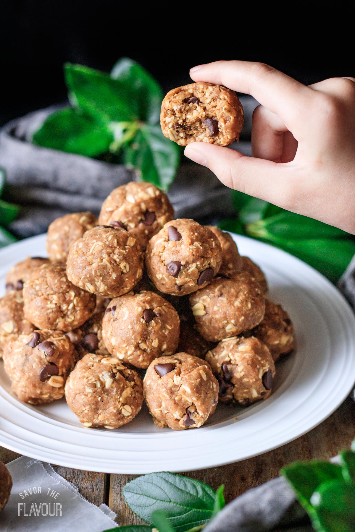 person holding half of a protein ball