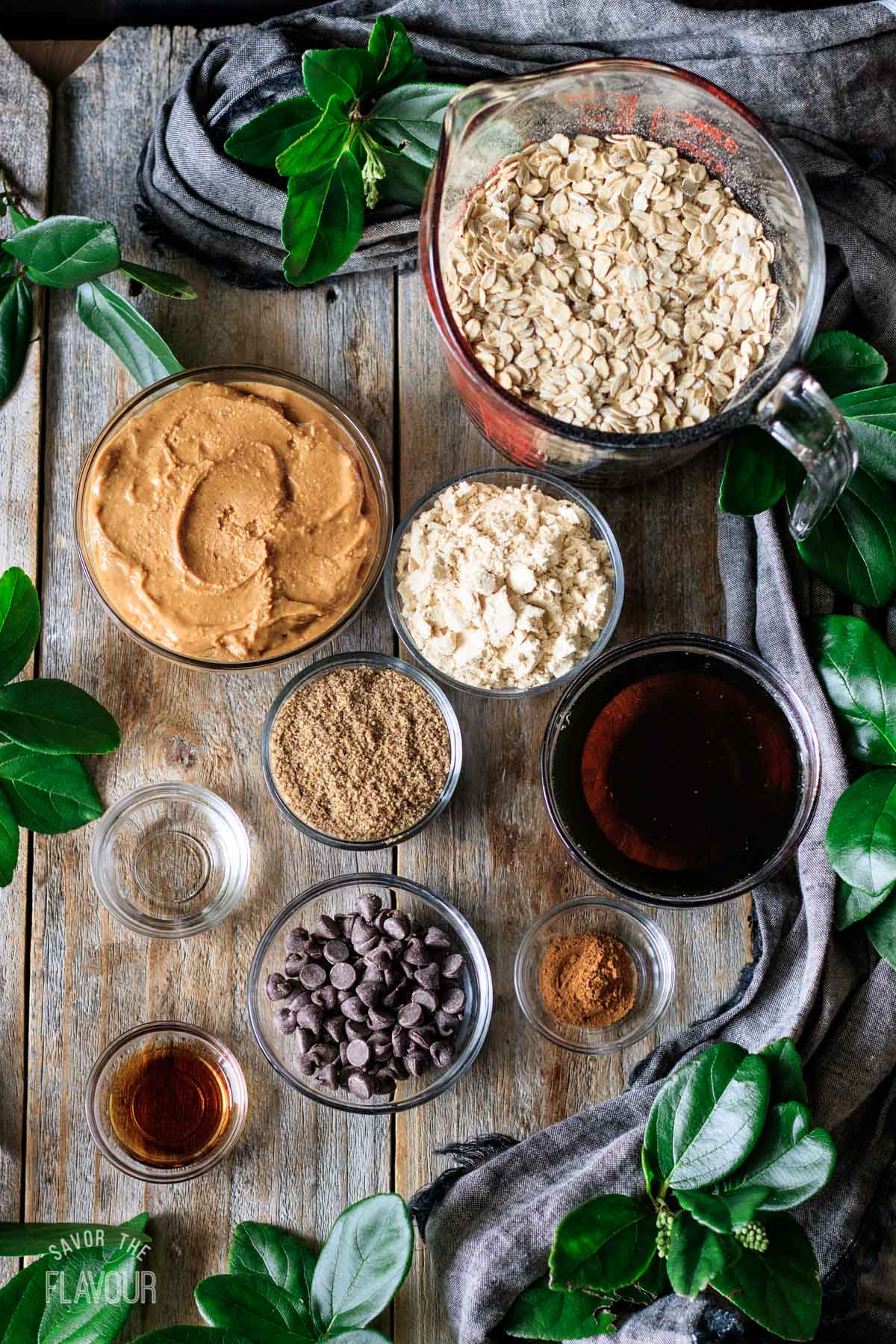 bowls of ingredients for vegan peanut butter protein balls