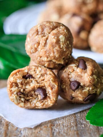 stack of vegan protein balls on a sheet of wax paper