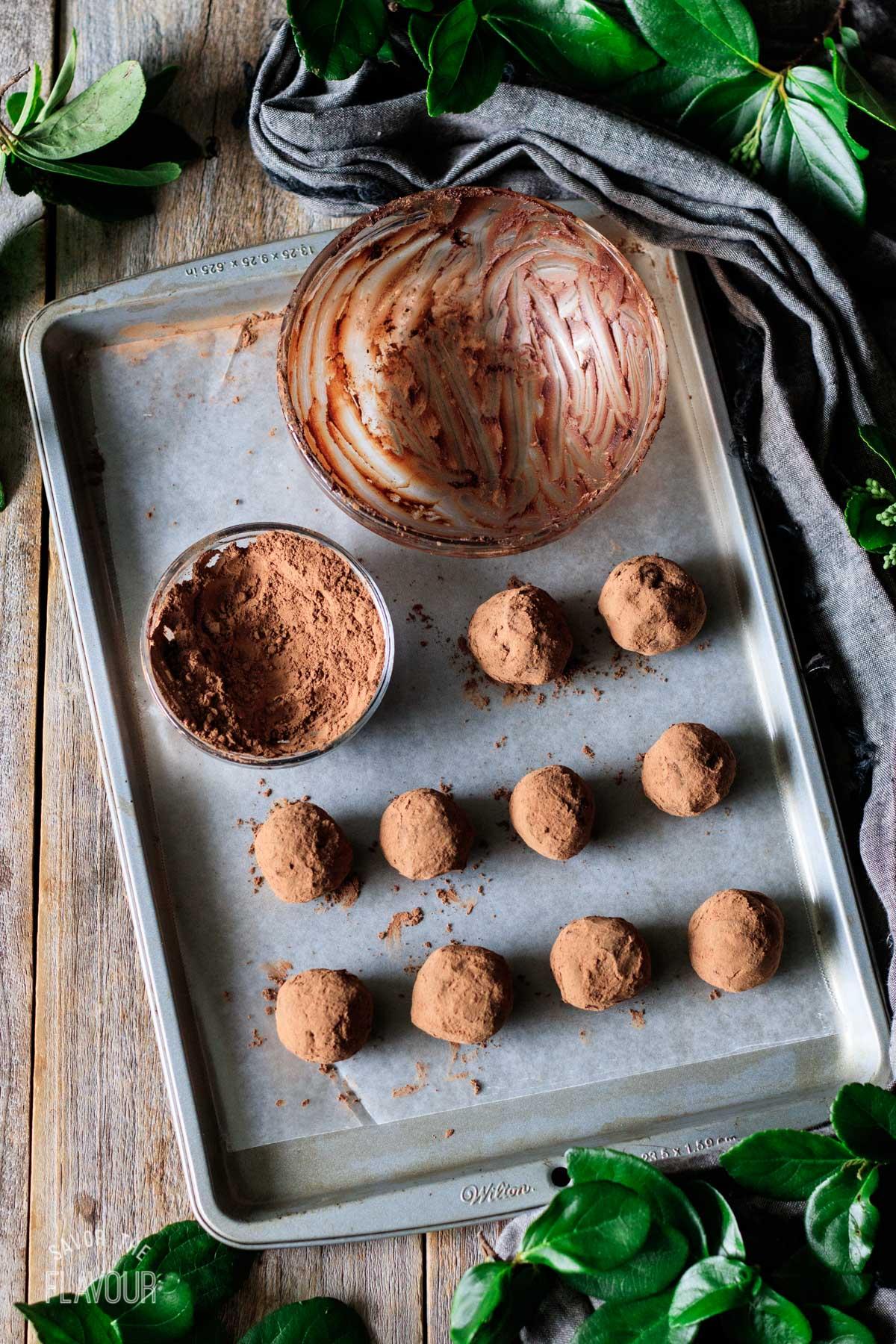 chocolate raspberry truffles on a cookie sheet
