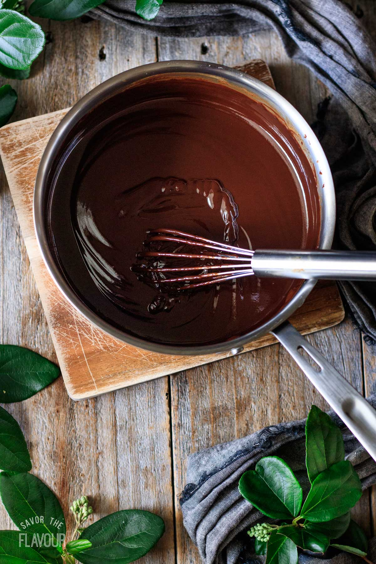 coffee chocolate ganache in a saucepan with a whisk