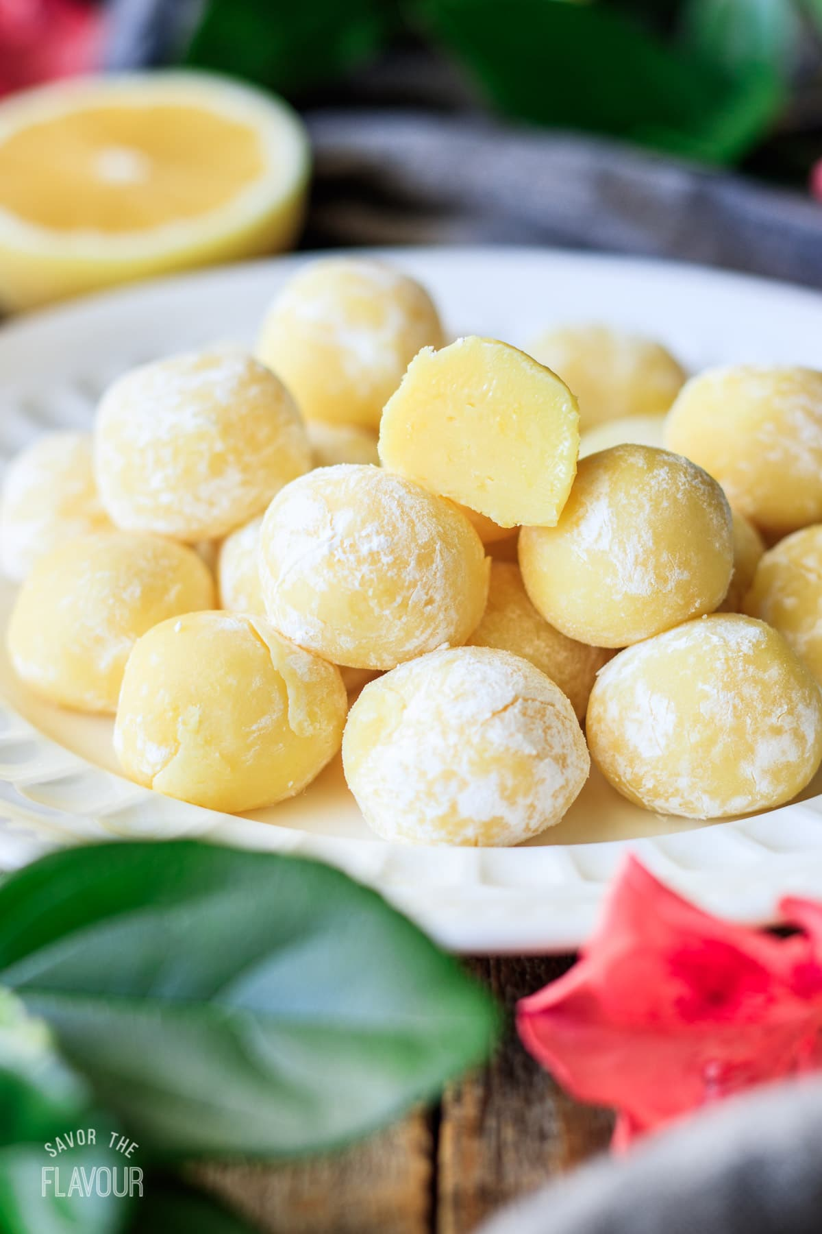 white plate piled with lemon truffles