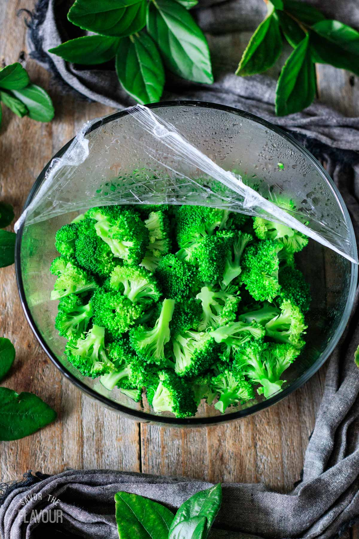 steamed broccoli florets in a glass bowl