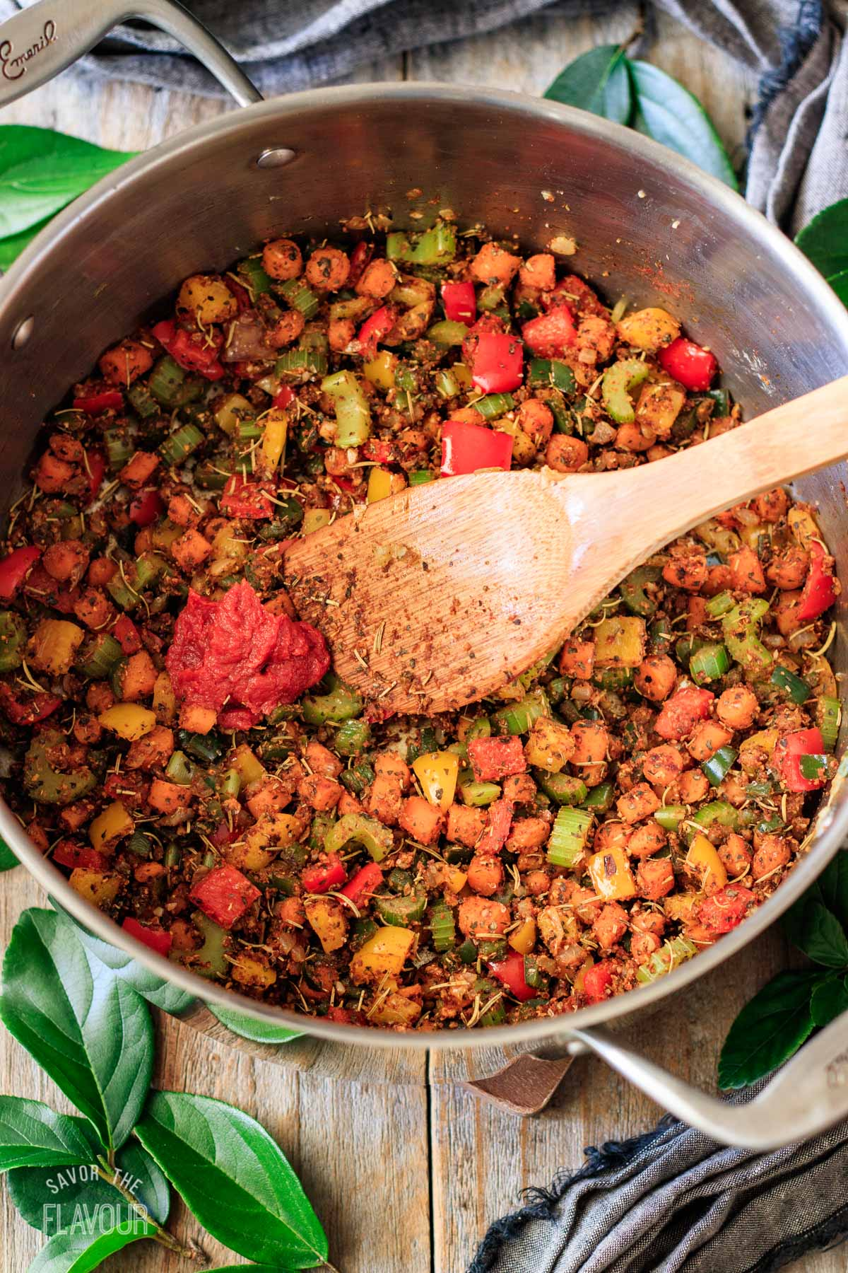 sauteed veggies with spices and tomato paste in a pot