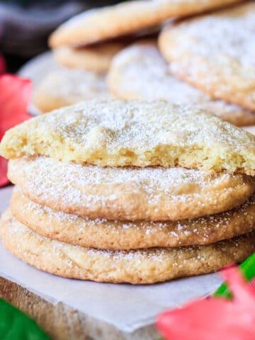 stack of three lemon drop cookies with one broken in half