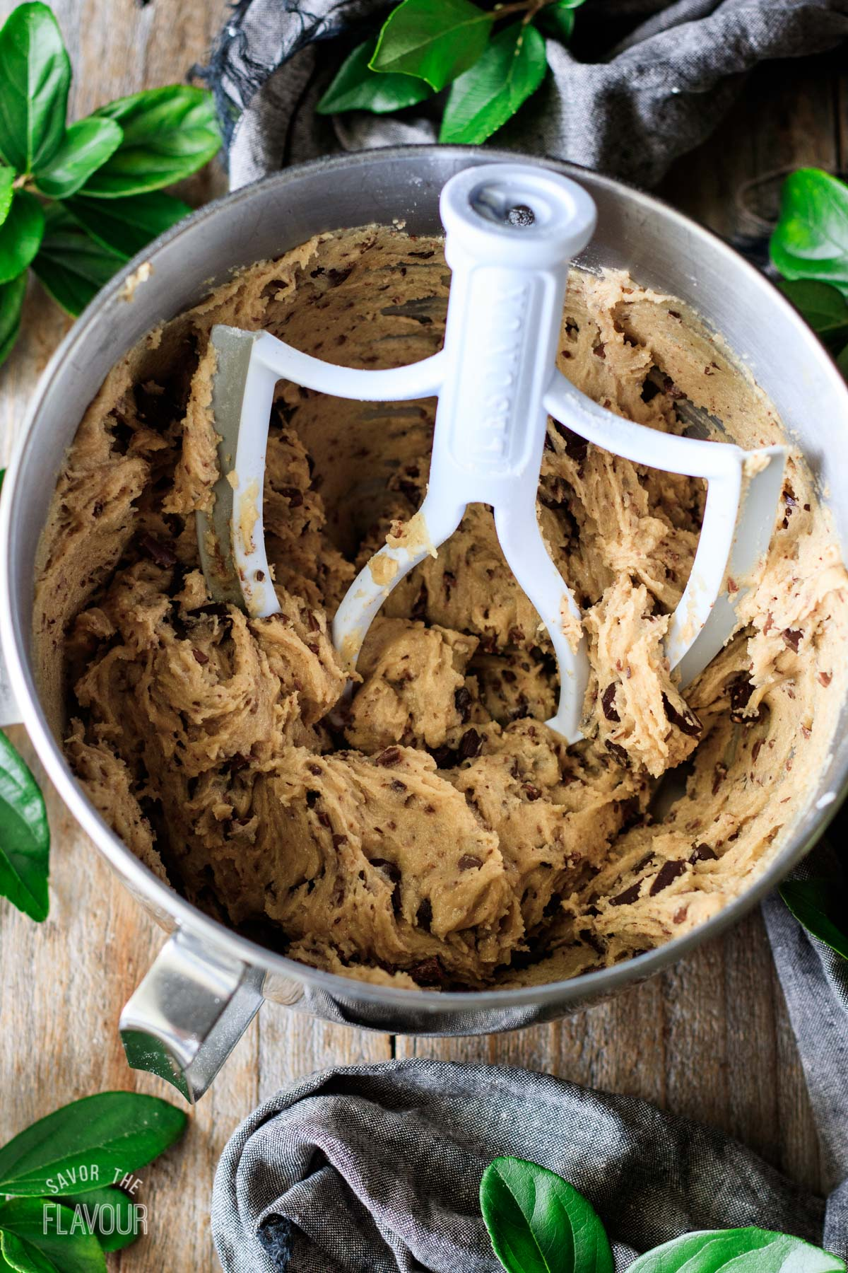 mixing bowl of cookie dough with the chocolate chunks mixed in
