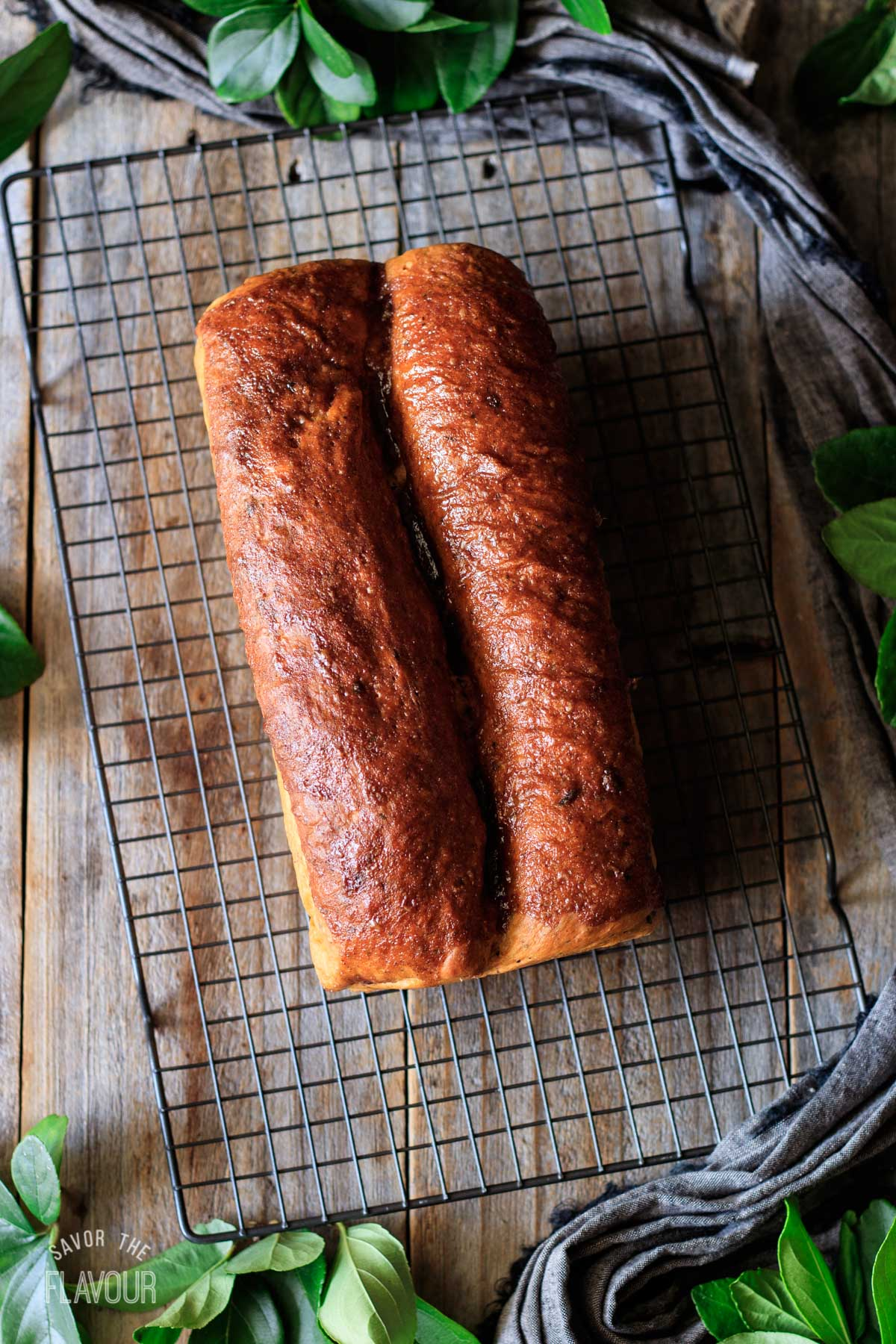 baked tomato basil bread with a sweet glaze brushed on top