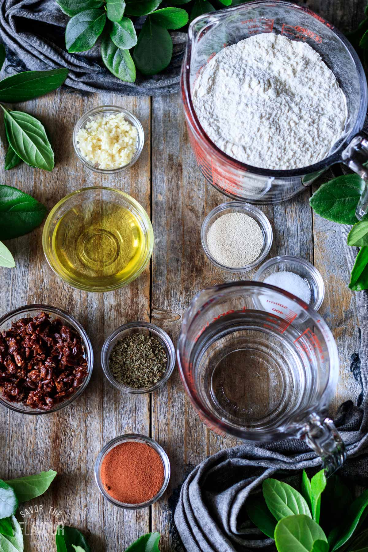 glass bowls of ingredients for tomato basil bread