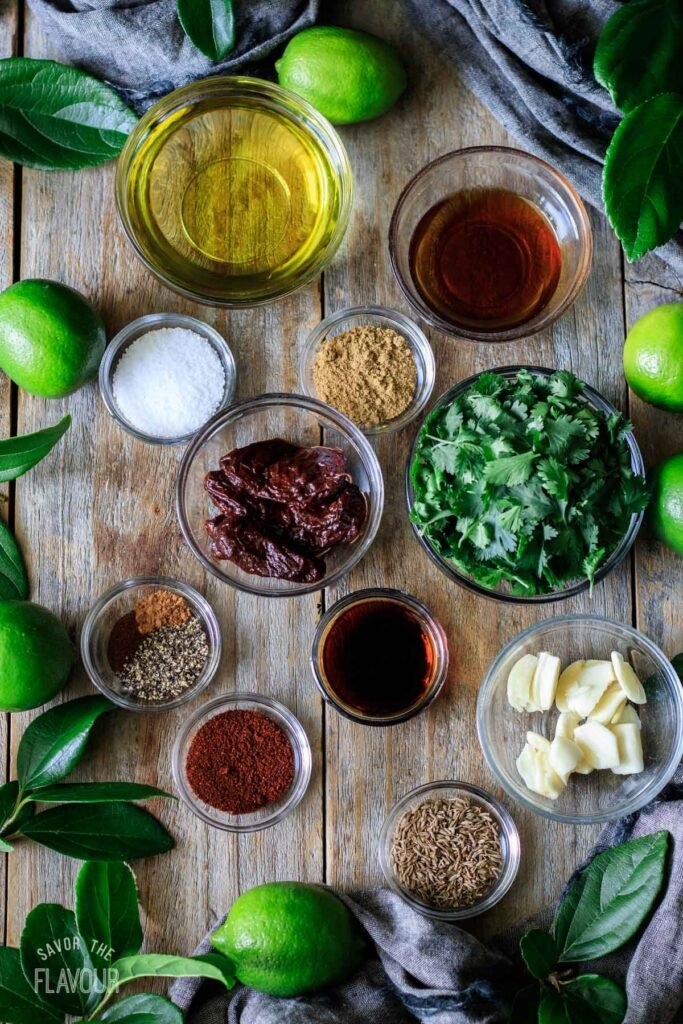 glass bowls of ingredients for the steak marinade