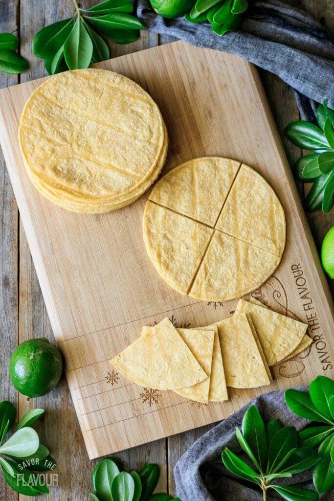 cutting corn tortillas into quarters
