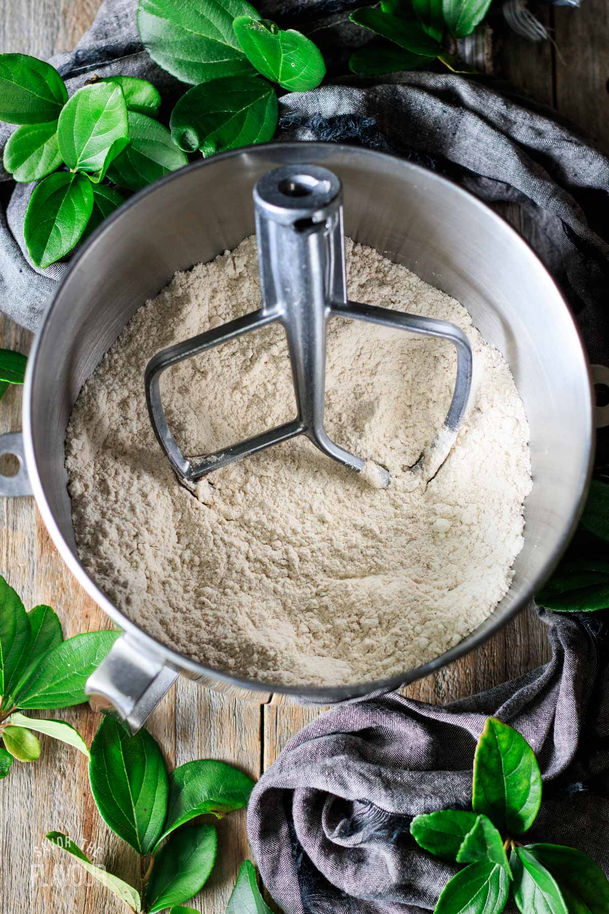 flour mixture in a stand mixer bowl with the paddle attachment
