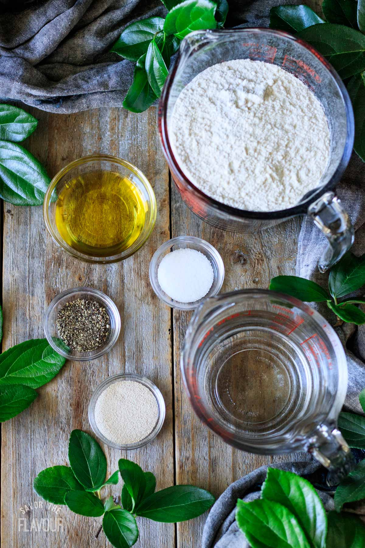 glass bowls of ingredients for black pepper focaccia