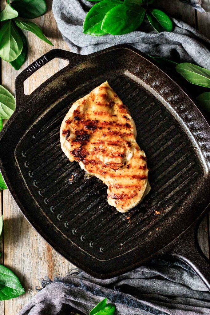 grilled chicken breast in a cast iron grill pan