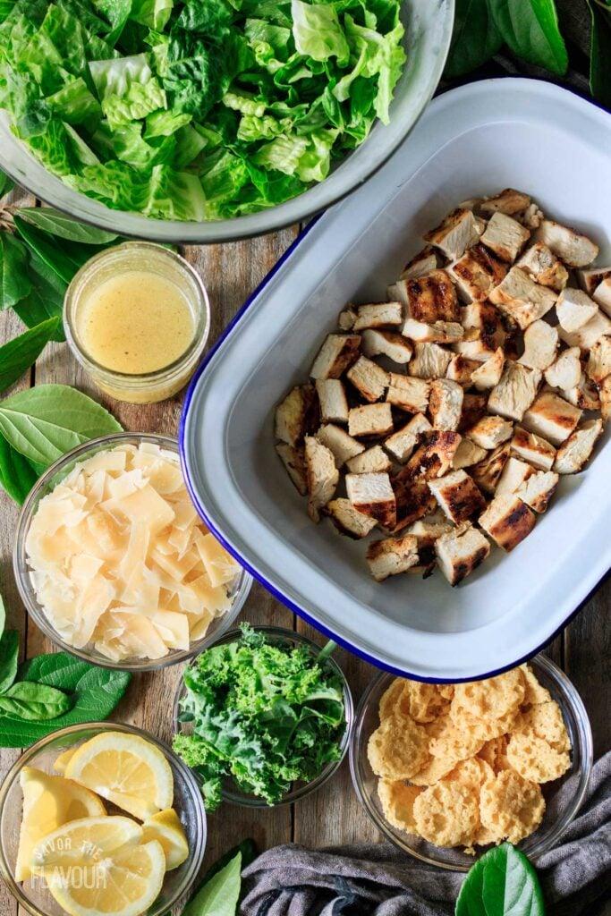 bowls of ingredients for the lemon kale Caesar salad