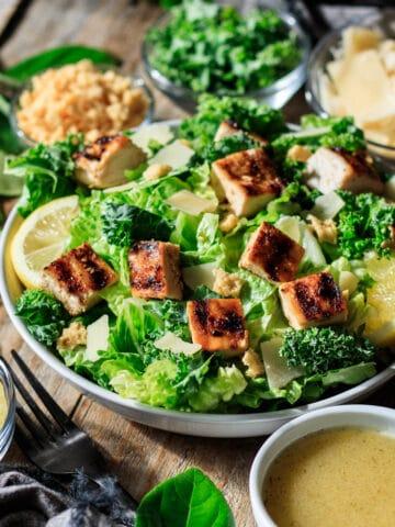 bowl of lemon kale Caesar salad with a fork