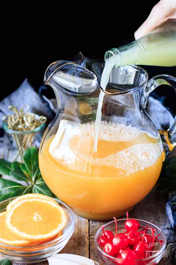 pouring juices into a pitcher