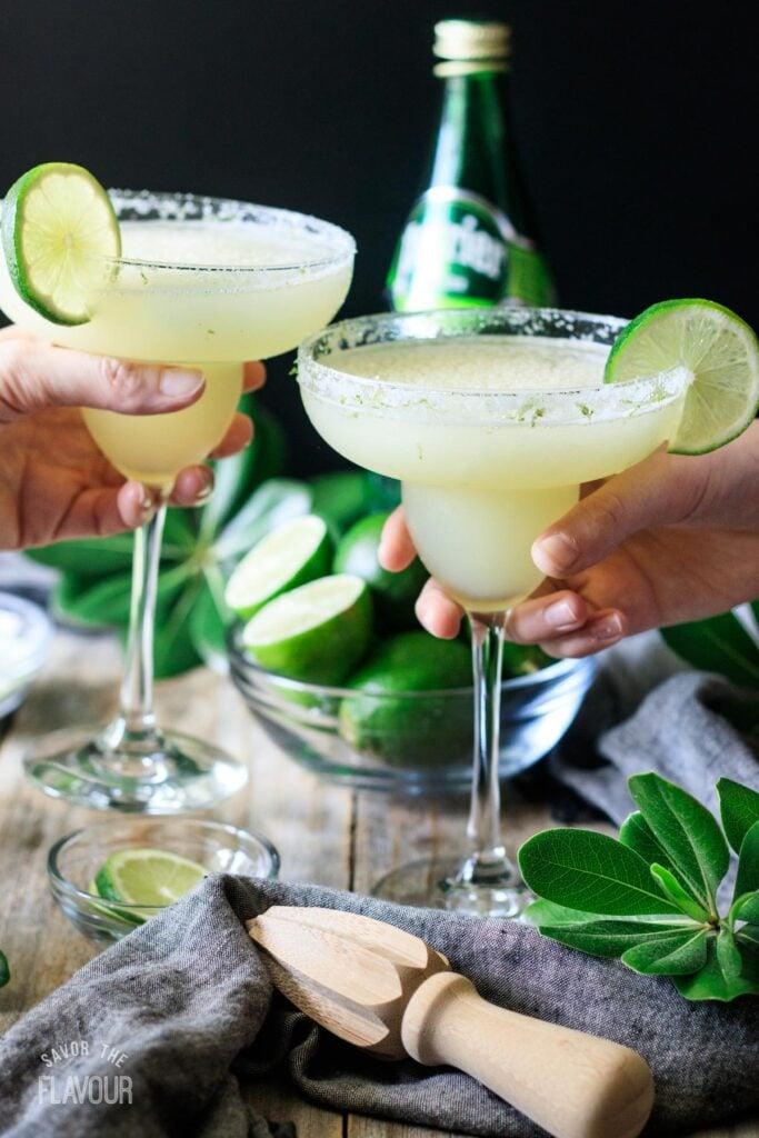 two people toasting with virgin lime margitas
