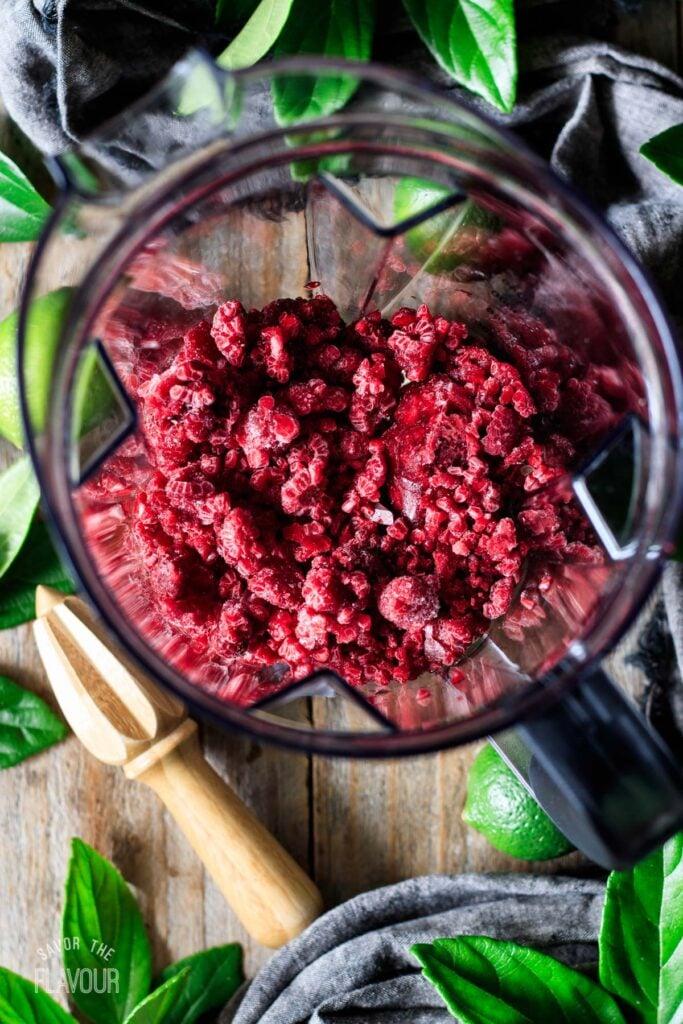 frozen raspberries in a blender