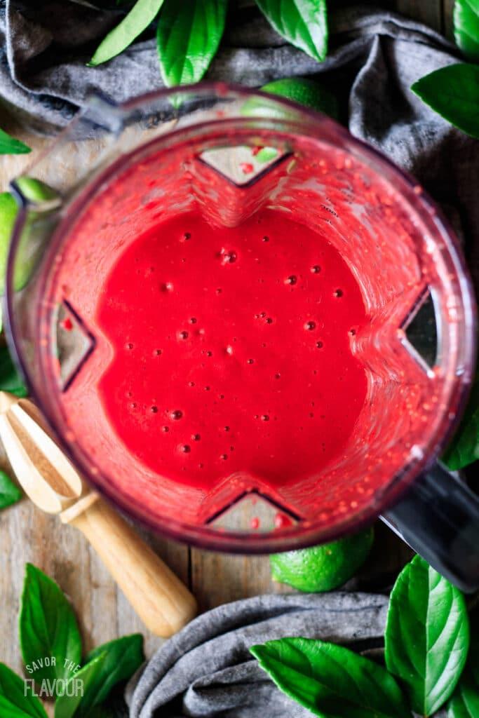 pureed raspberries in a blender