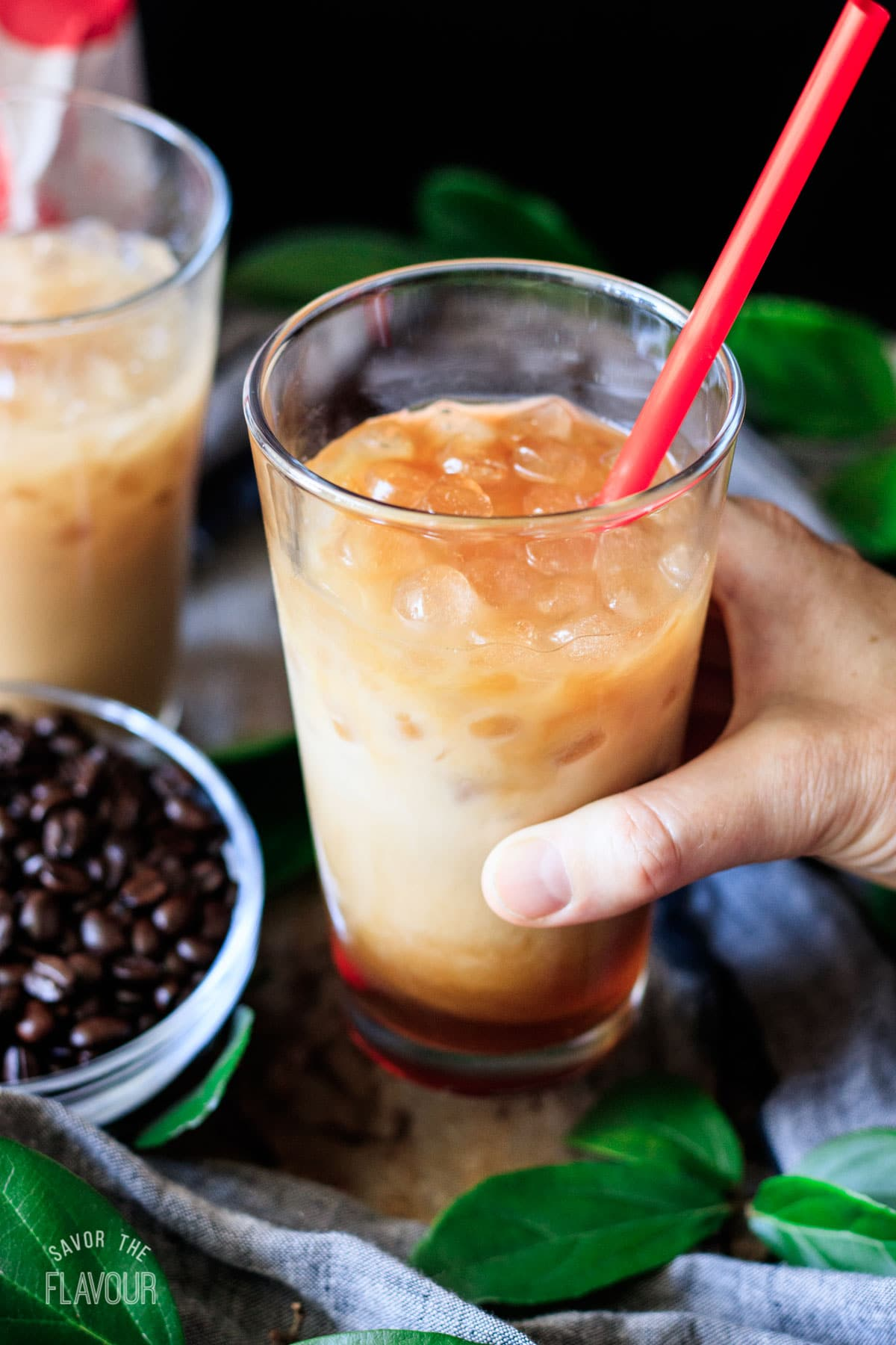 person holding a glass of Chick-fil-A iced coffee