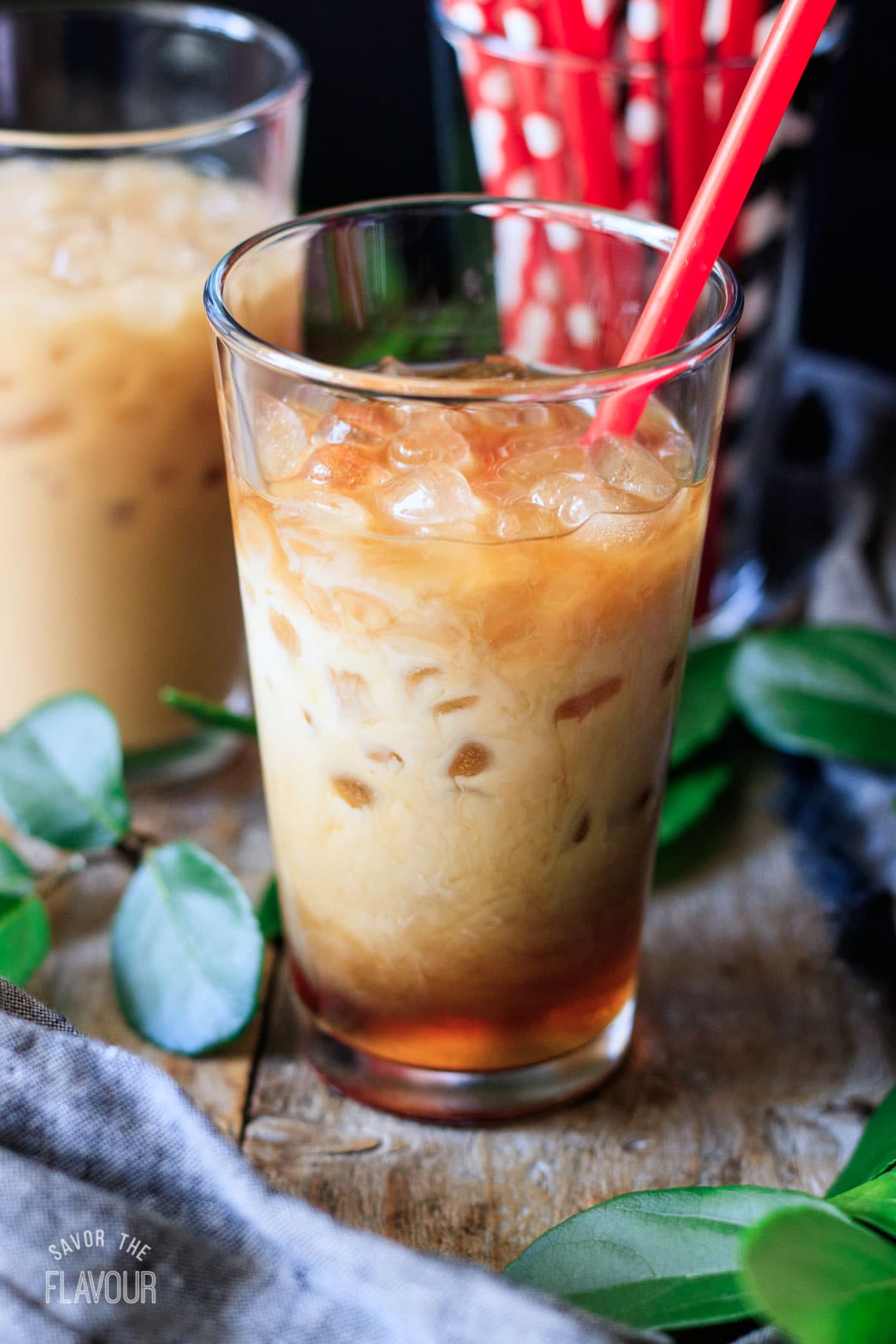 a glass of Chick-fil-A iced coffee with a red straw