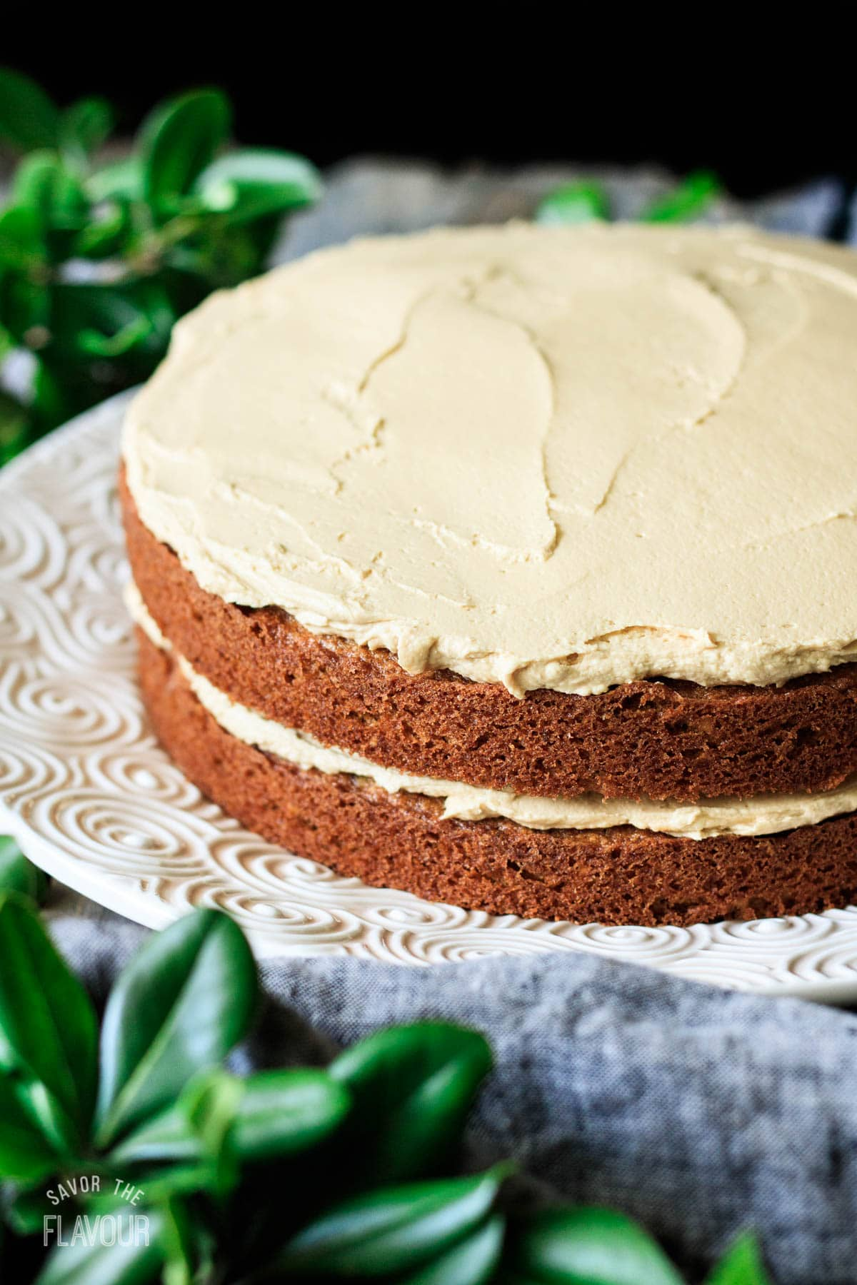 two coffee walnut cake layers sandwiched with buttercream