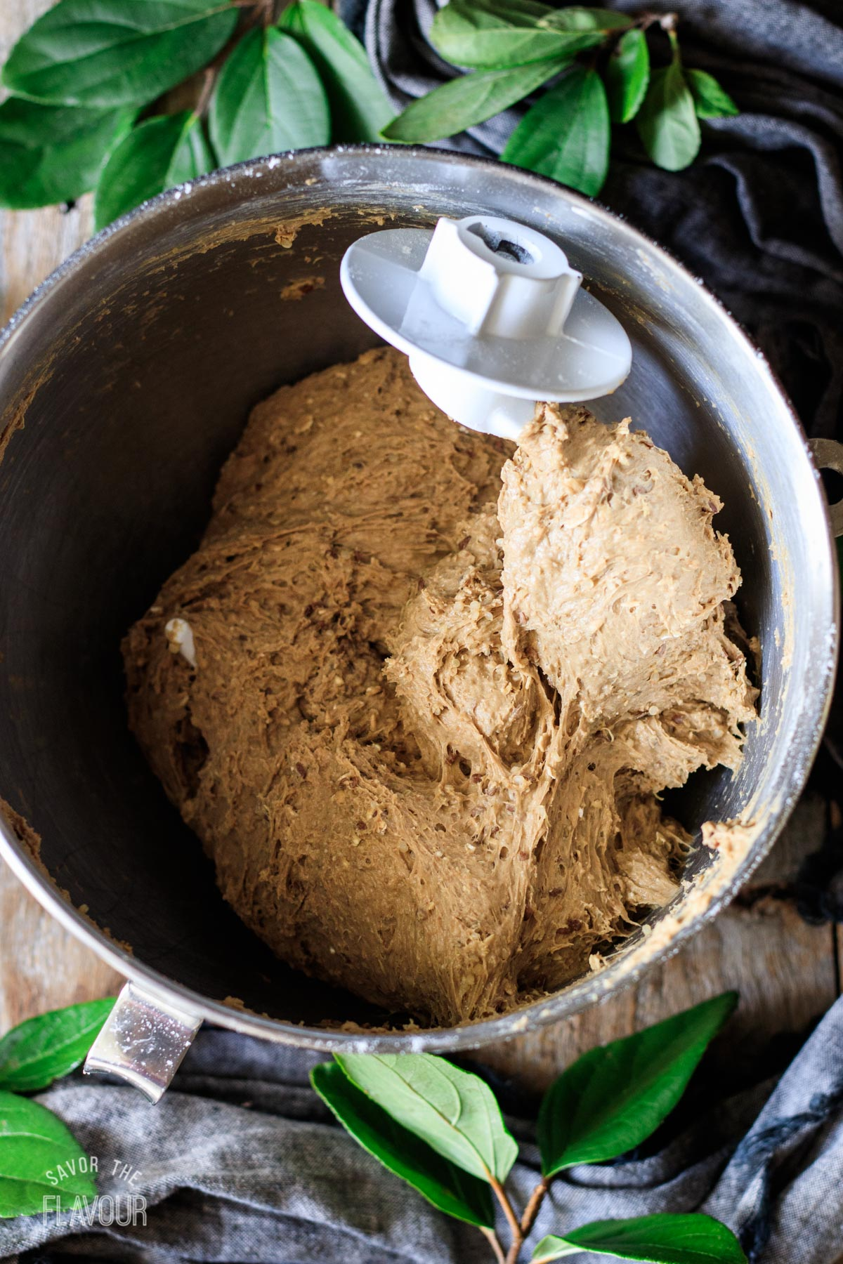 kneaded bread dough in a mixing bowl