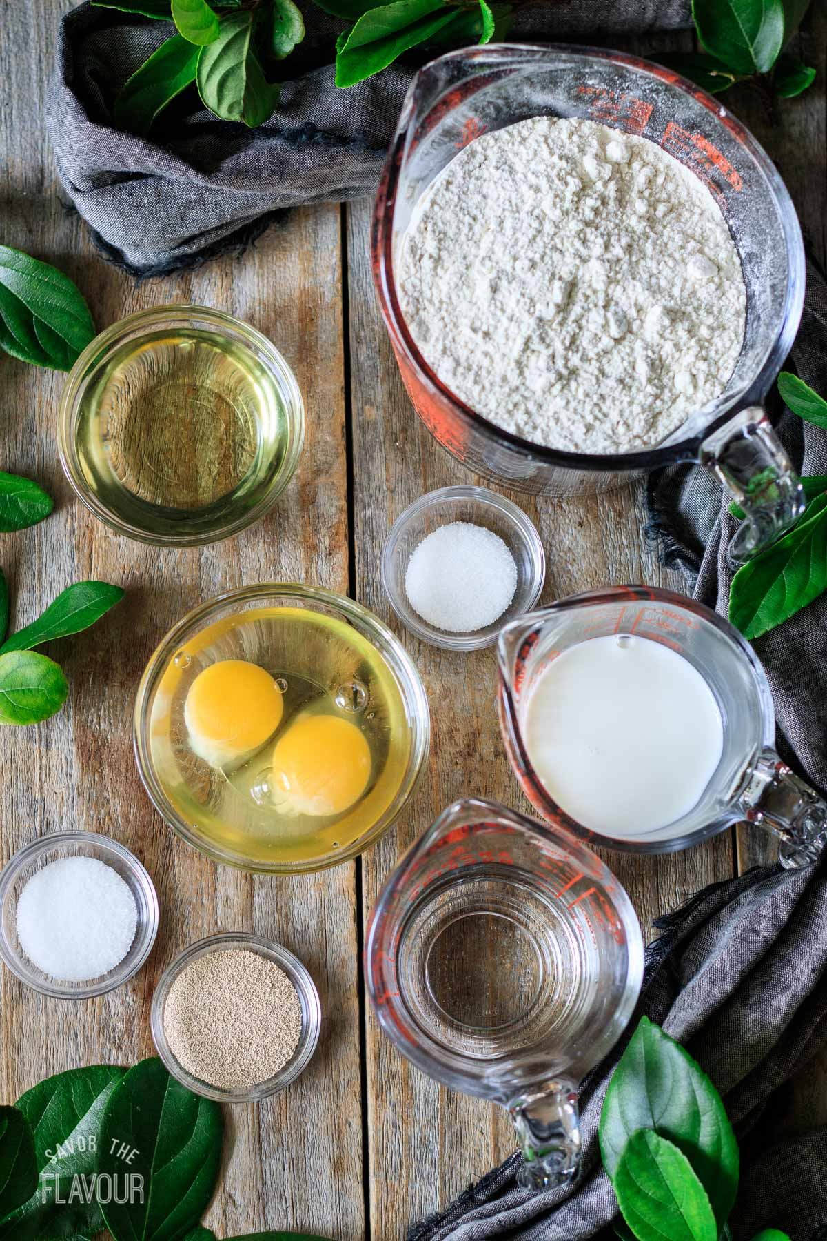 glass bowls of ingredients for pane bianco dough