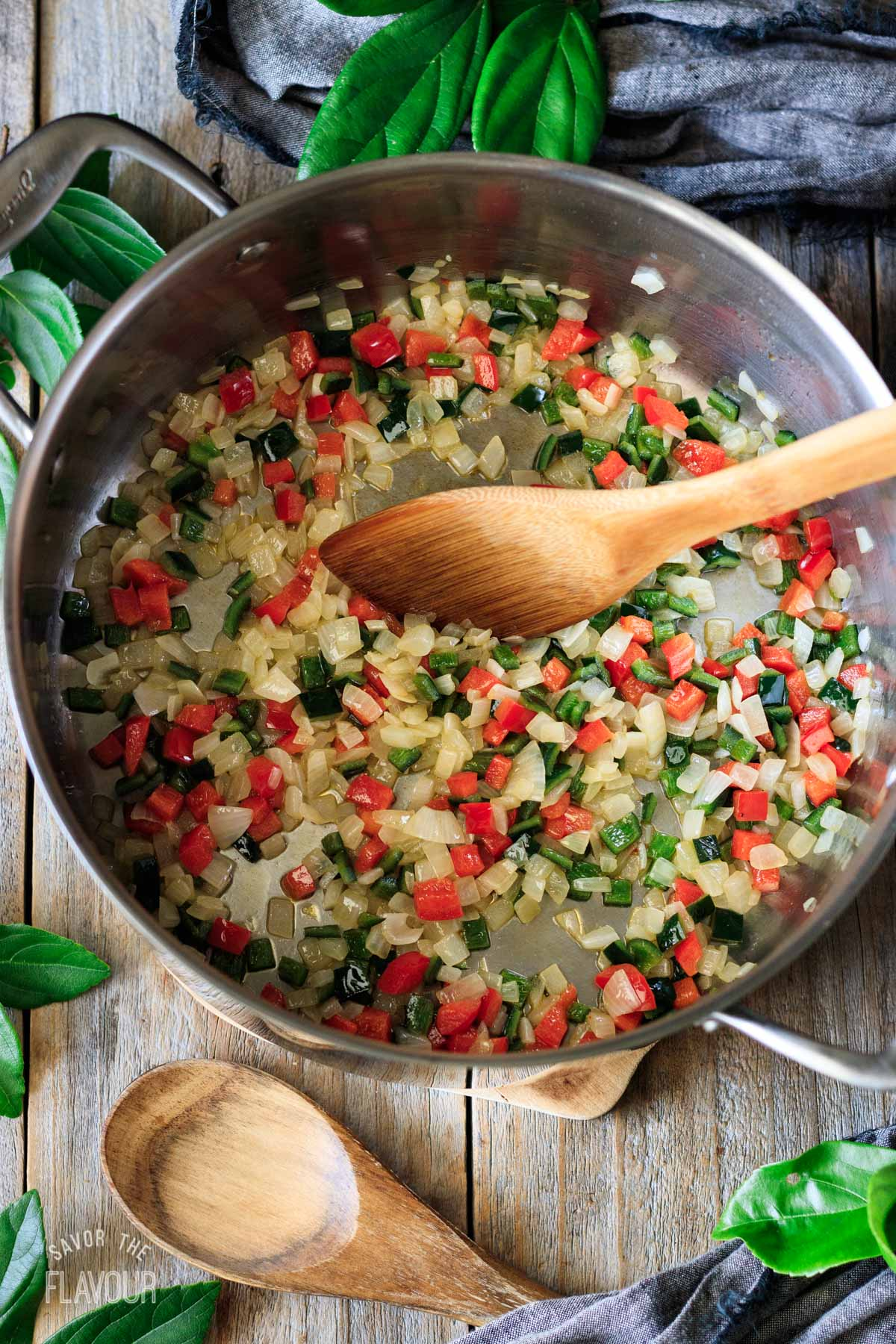sauteed peppers and onions in a soup pot