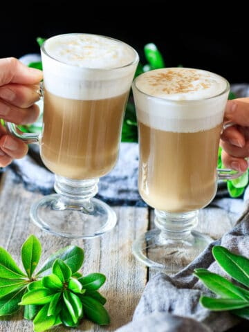 people toasting with two smoked butterscotch lattes