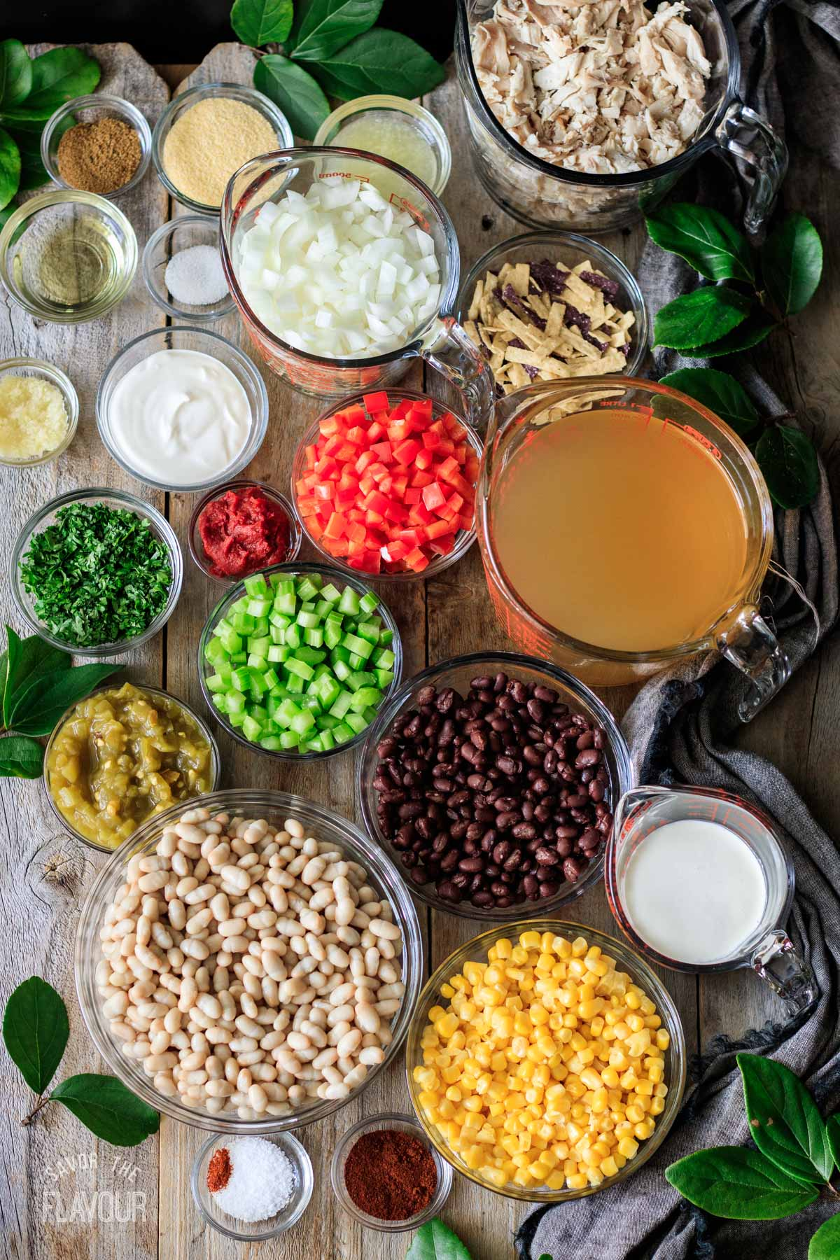 glass bowls of ingredients for chicken tortilla soup