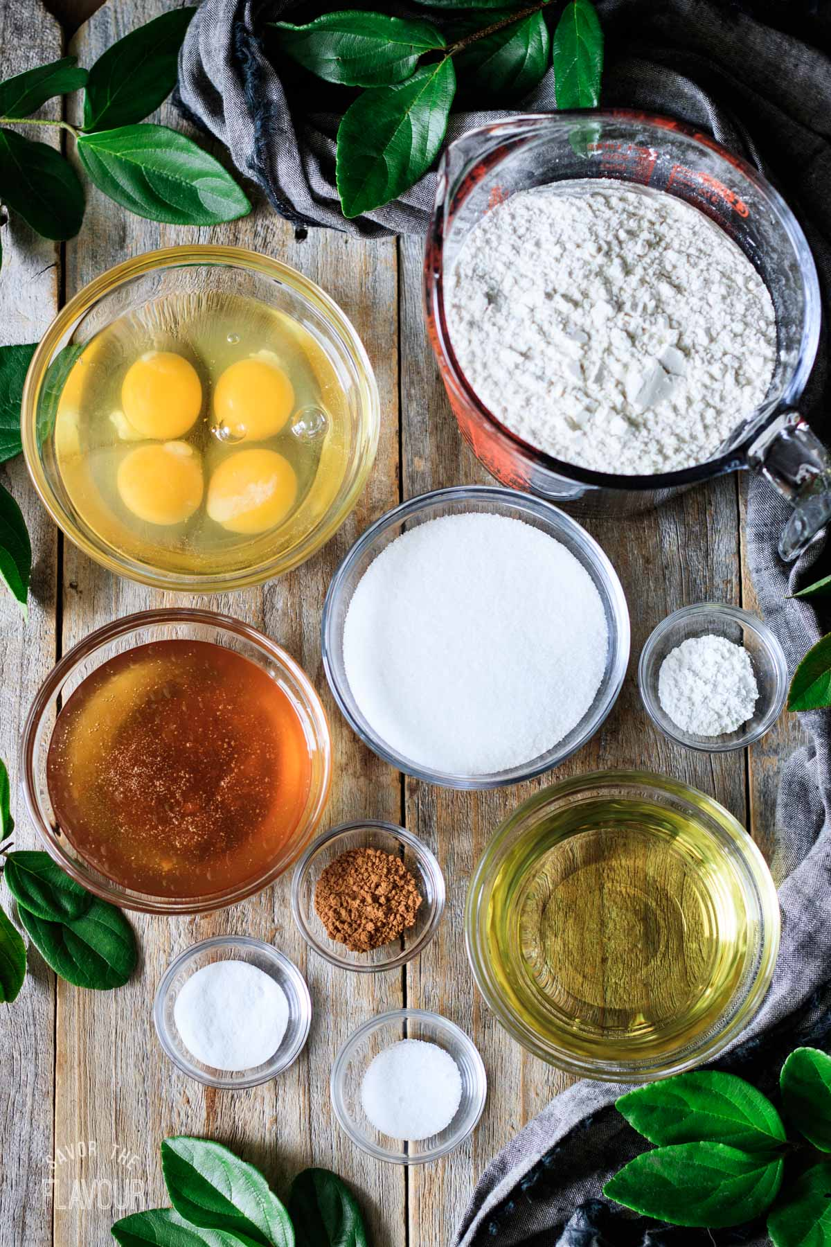 glass bowls of ingredients for honey cookies