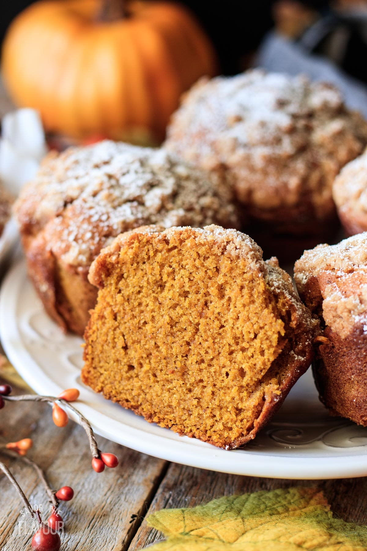 half of a Panera pumpkin muffin on a white plate