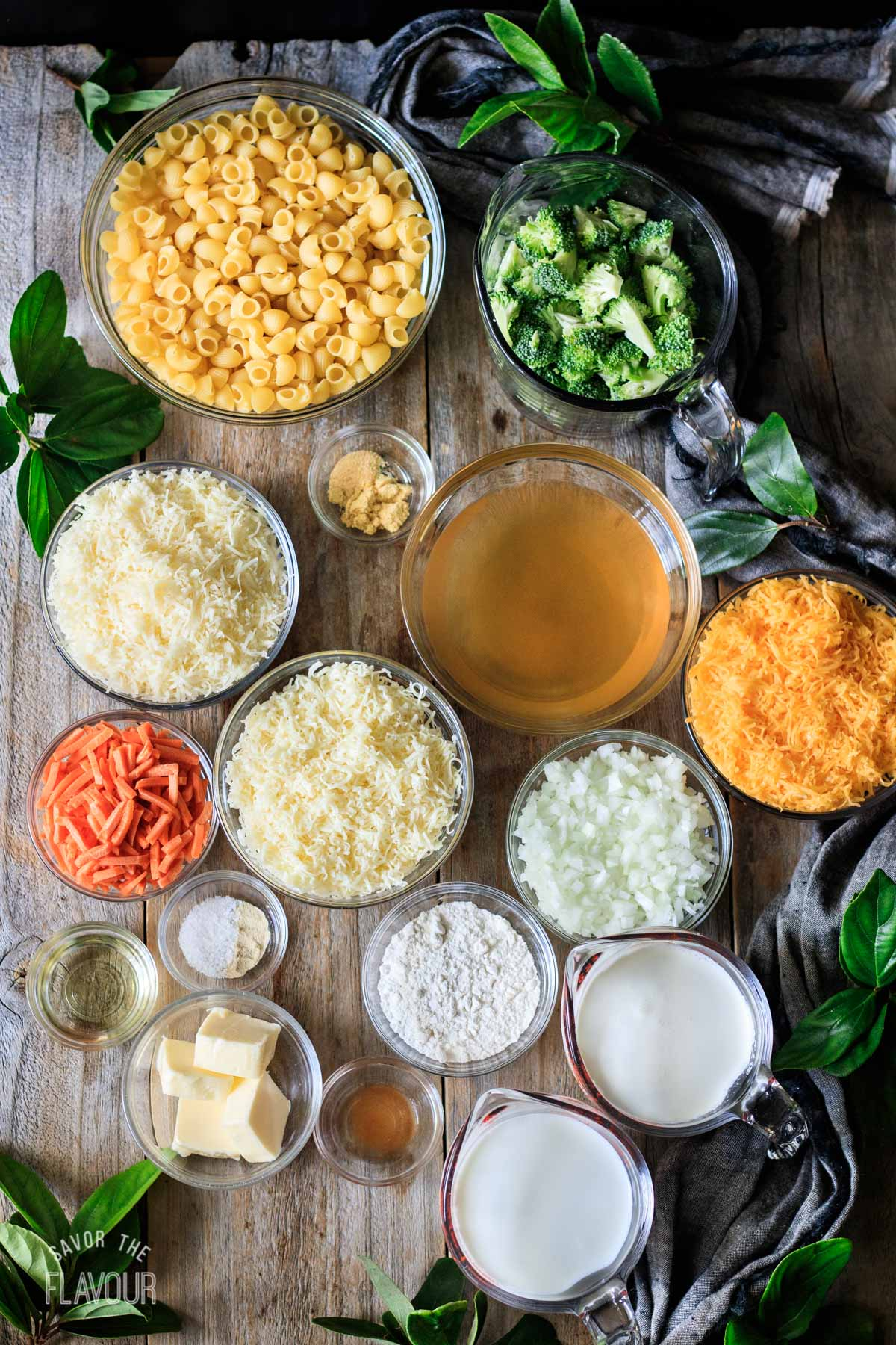 glass bowls of ingredients for broccoli cheddar mac and cheese